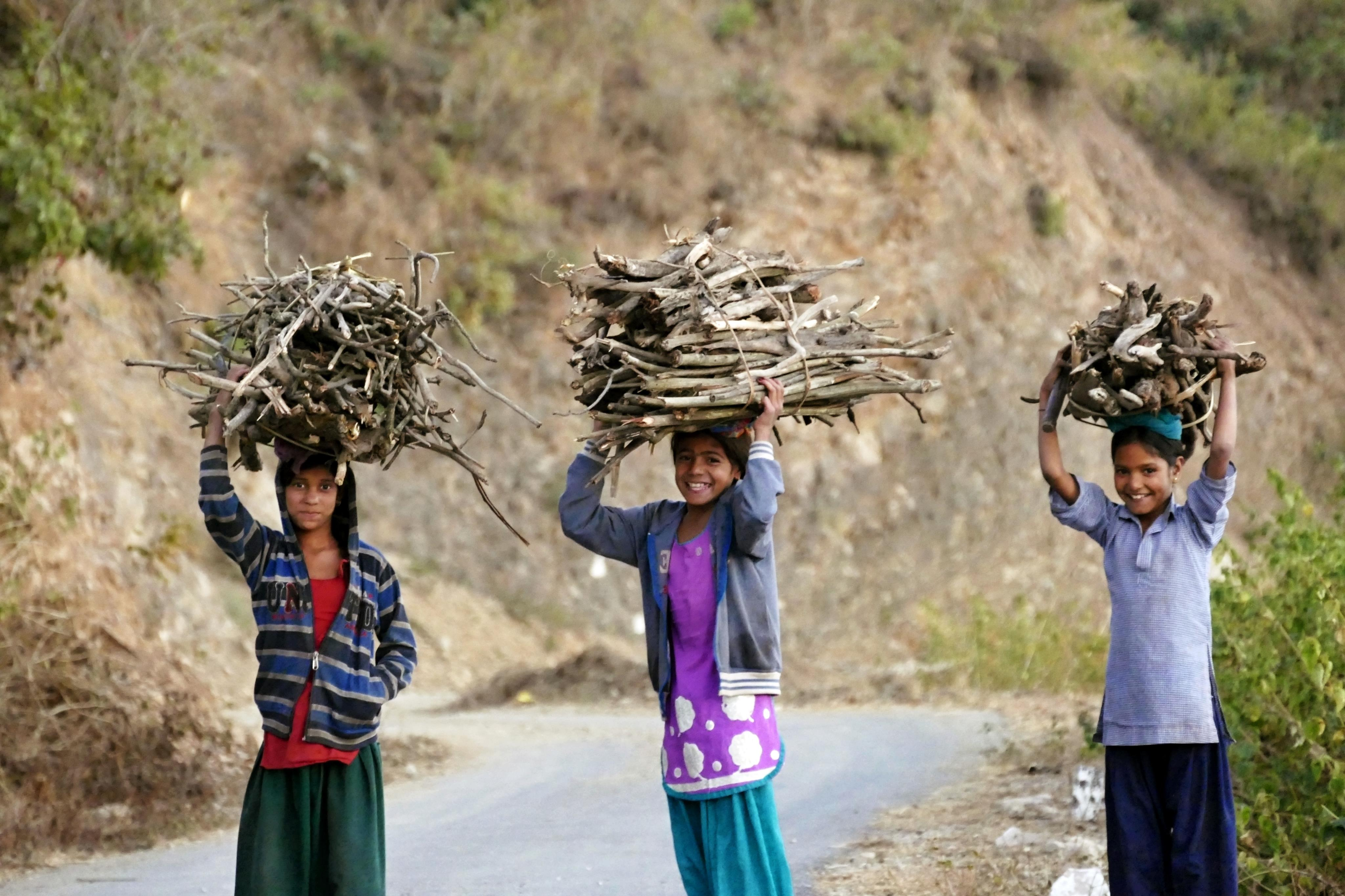 Village children with woods for home