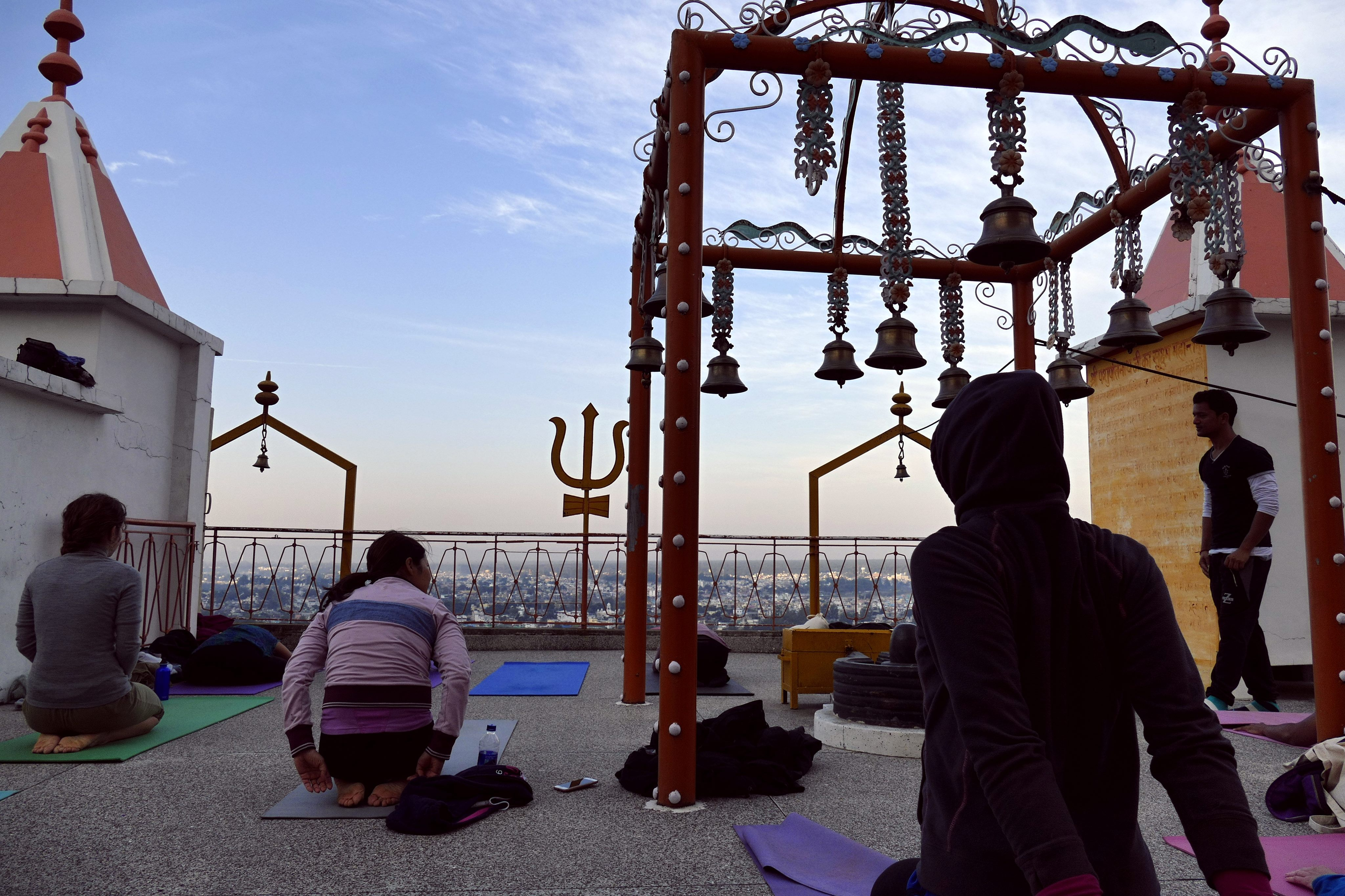 Roof top yoga at Temple